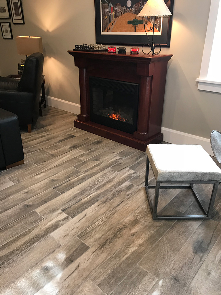 Hardwood TILE in Artistica Euforia keeps your family room cozy while being maintenance free. Perfect for all areas, in floor heat and basements.